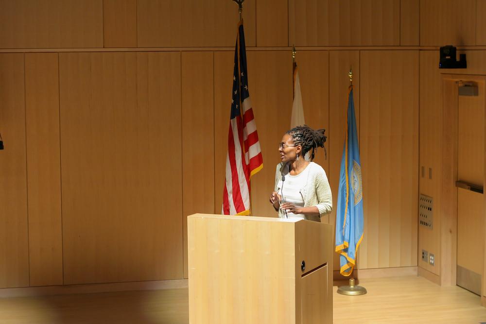 Kim McLarin stands behind a podium.